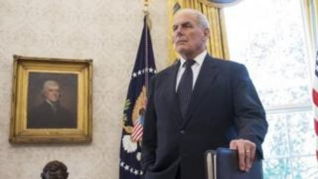 White House chief of staff John Kelly listens as US President Donald Trump speaks to the media at the White House.