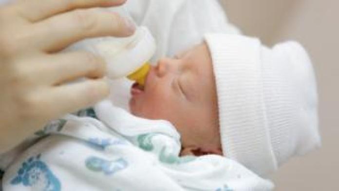 Bottle feeding a newborn baby