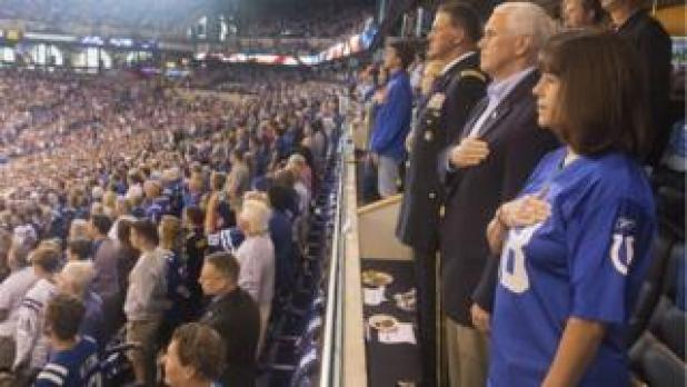 Mike Pence tweeted a photo of himself standing during the US national anthem at an NFL game on Sunday, 8 October 2017