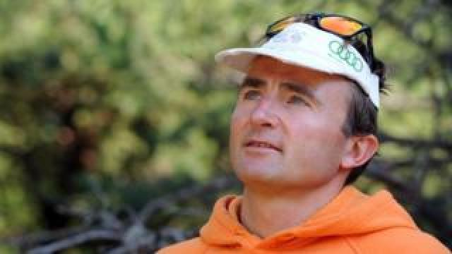 Swiss climber Ueli Steck posespictured in Sigoyer, in the Hautes-Alpes department of south-eastern France, on August 13, 2015