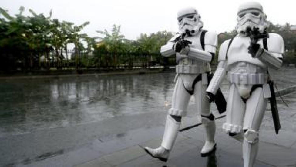 A pair of Storm Troopers walk through Jackson Square in the French Quarter of New Orleans, Louisiana, as strong winds and heavy rain from Hurricane Nate begin to come ashore, 7 October 2017