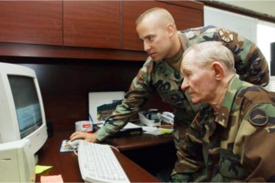 In this handout photo from U.S. Army, alleged U.S. Army deserter Sergeant Charles R. Jenkins (R) receives training on a computer from Staff Sgt. Andrew Rogerson, the U.S. Army Garrison Japan training noncommissioned officer and Jenkins's supervisor, at Camp Zama in 17 September 2004 in Zama, Japan