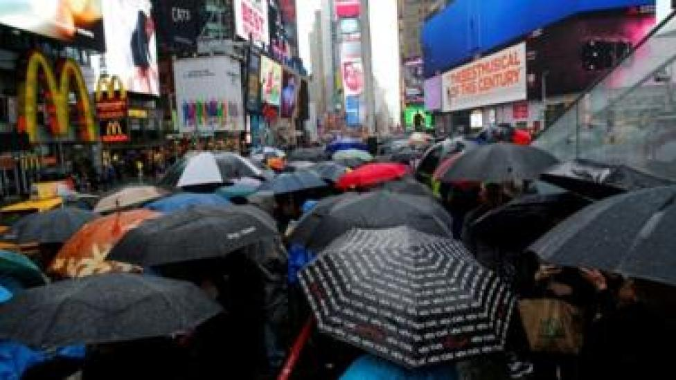 People walk in the rain in Times Square in New York (13 April 2017)