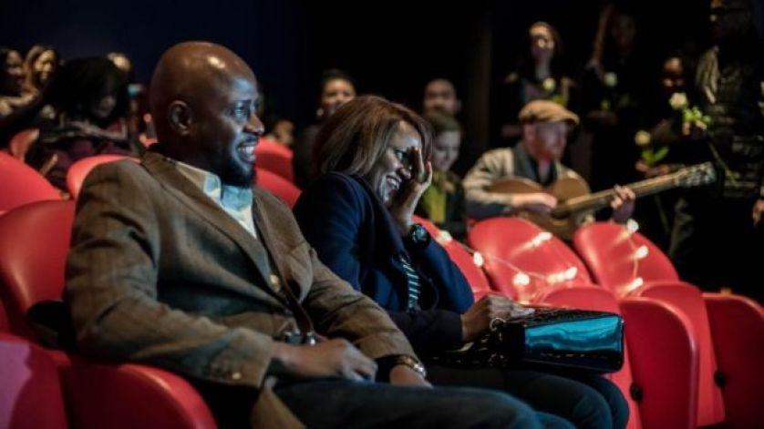 أنتوني ويليامز وزوجته حالياً دَمبي خلال العرض السينمائي