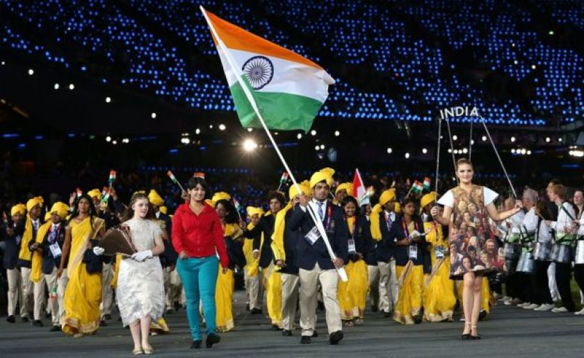 Sushil Kumar of the India Olympic wrestling team carries his country's flag during the Opening Ceremony of the London 2012 Olympic Games at the Olympic Stadium on July 27, 2012 in London, England.