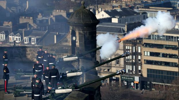 Members of the 29 Commando Regiment Royal Artillery fire a 21-gun salute at Edinburgh Castle