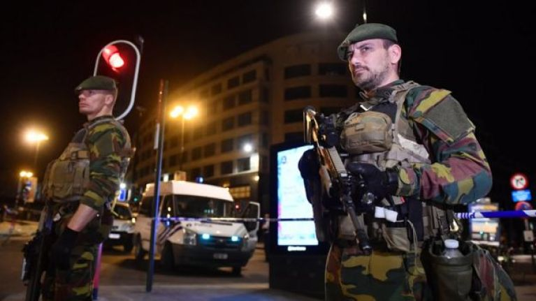 Armed police stand guard outside Brussels Central train station