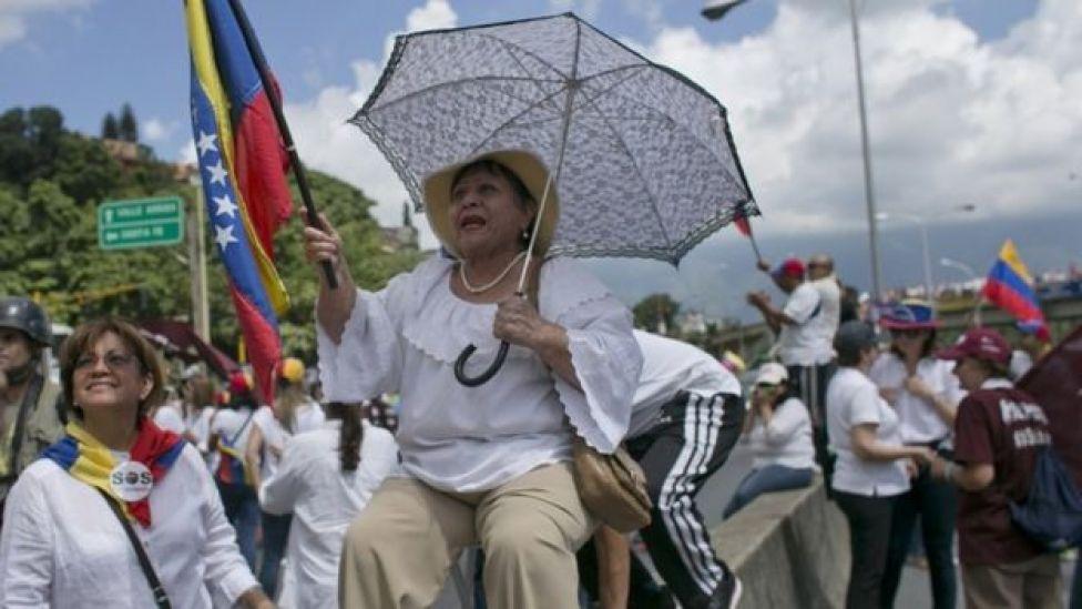 A woman during a protest demanding a recall referendum against Venezuela