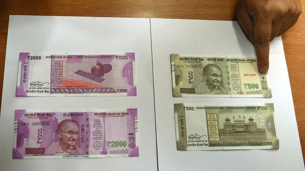 Samples of the new 500 and 2,000 rupee notes are displayed at the Reserve Bank of India headquarters in Mumbai