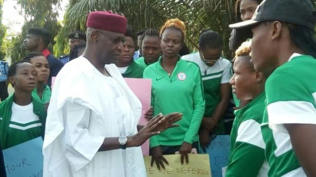 Malam Abba Kyari, the President's chief of staff, talking to the Super Falcons outside the presidential villa
