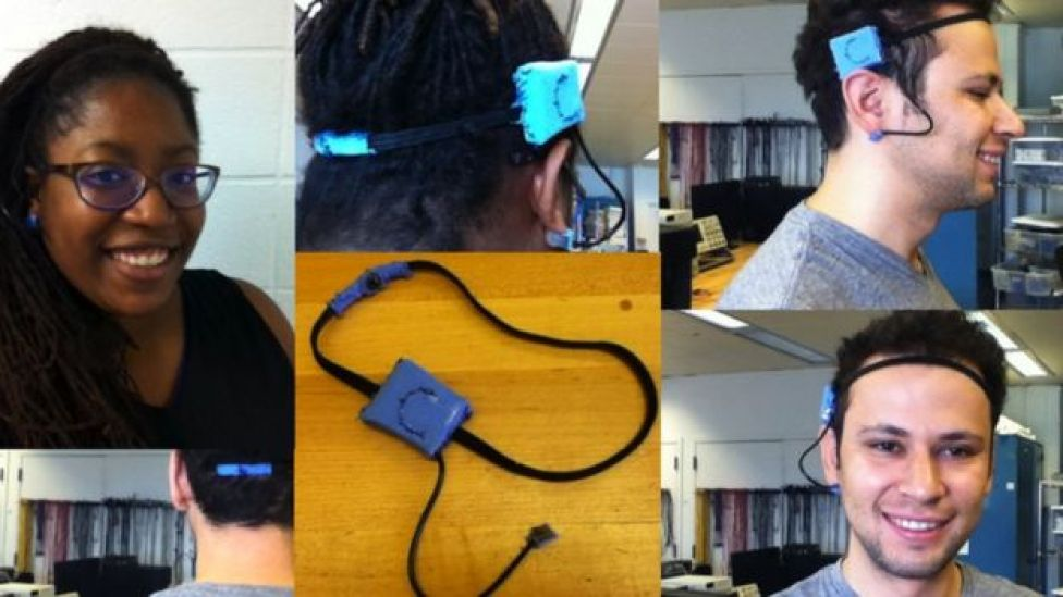 Kay Igwe and the brain-powered game controller modelled by a male user