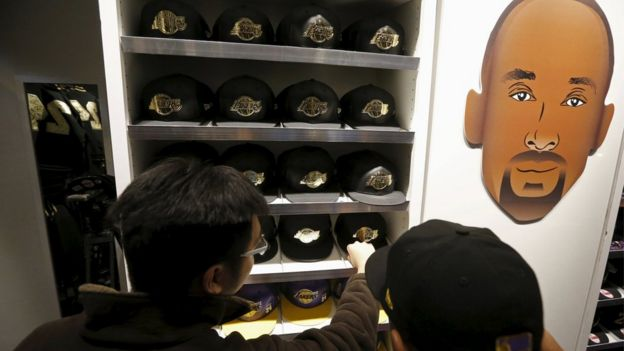 Fans shop for Kobe Bryant souvenirs in the Lakers store at Staples Center