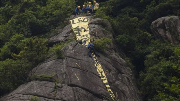 Giant democracy banner on Hong Kong hill ahead of China state leader visit