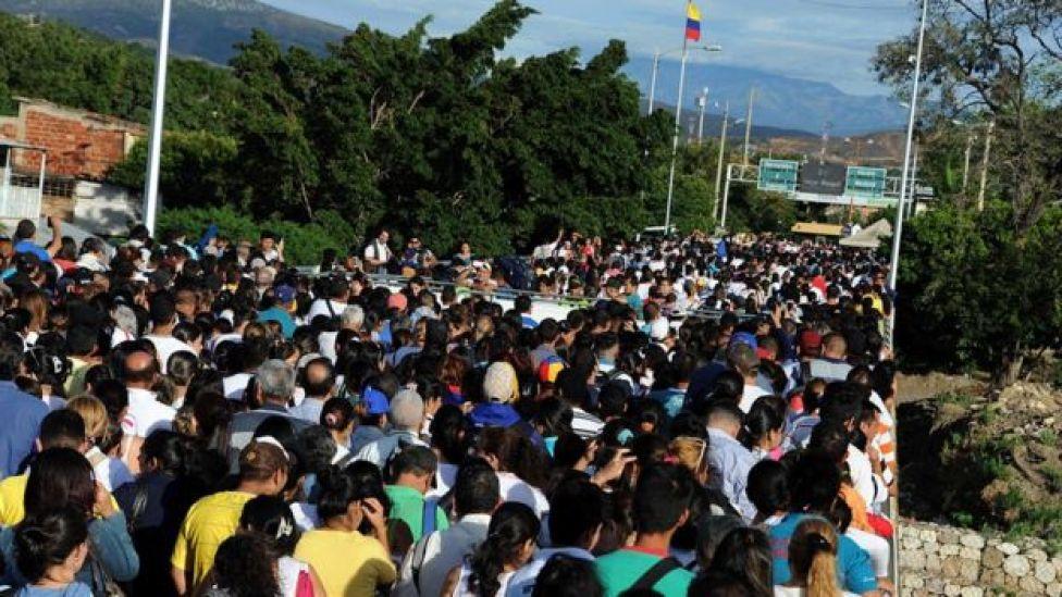 Venezuelans wait in San Antonio de Tachira, Venezuela to cross the border with Colombia on 10 July