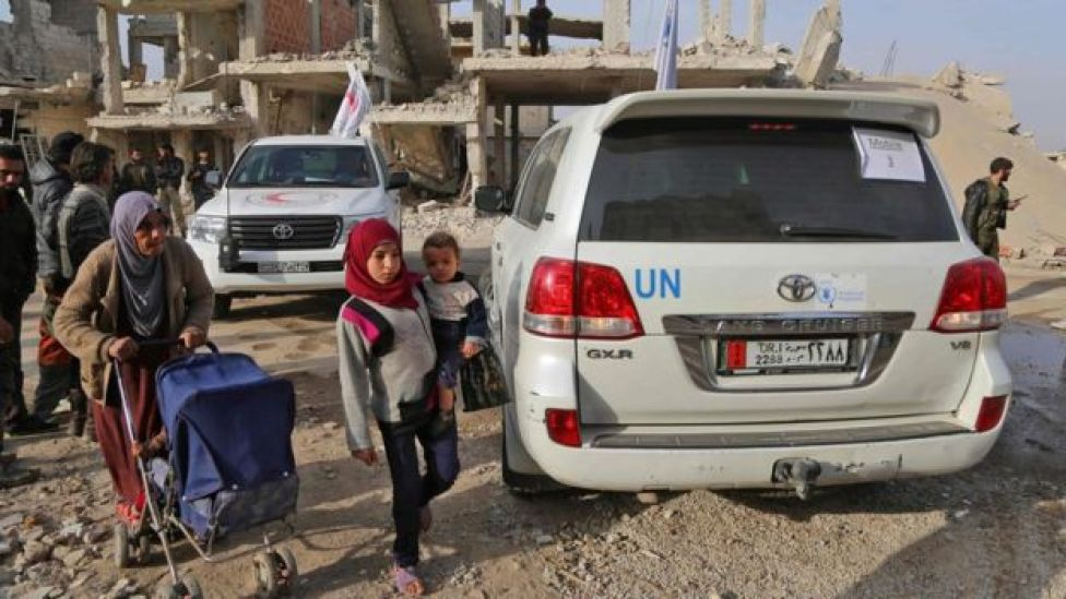 A child stands next to a World Food Programme vehicle in Nashabieh, in the Eastern Ghouta outside Damascus, Syria (28 November 2017)