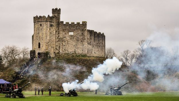 Members of C Troop 211 Battery fire a 21-gun salute in the grounds of Cardiff Castle
