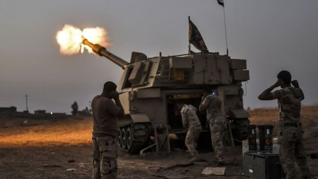 Iraqi forces fire shells on a village near Mosul