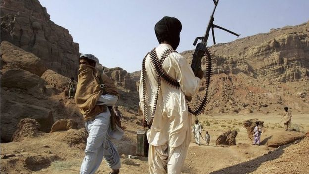 A Bugti guerrilla stands guard at a remote camp outside of Dera Bugti, in the province of Balochistan, Pakistan on January 22, 2006