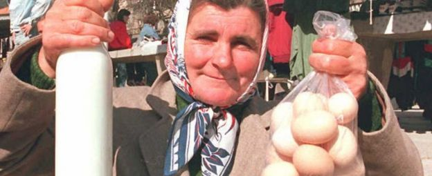 Serb woman holds milk and eggs