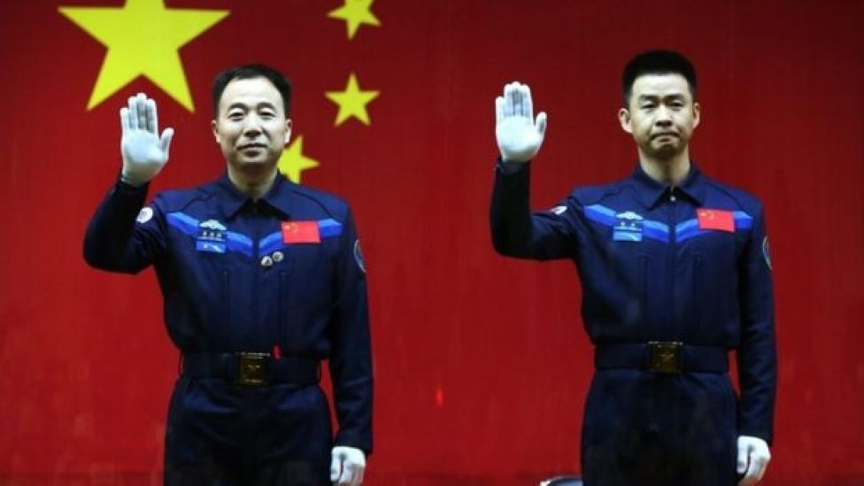 Chinese astronauts Jin Haipeng (L) and Chen Dong (R) on the eve of their mission to dock with the country's space station, 16 October 2016