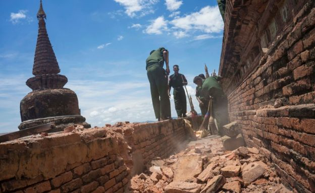 Military personnel clear debris at a temple that was damaged by a strong earthquake in Bagan, Myanmar, 25 August 2016.