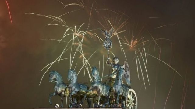 Fireworks explode next to the Quadriga sculpture atop the Brandenburg gate during New Year celebrations in Berlin (01 January 2016)