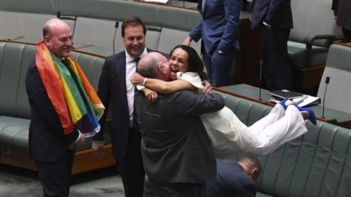 MPs Warren Entsch and Linda Burney embrace after the vote
