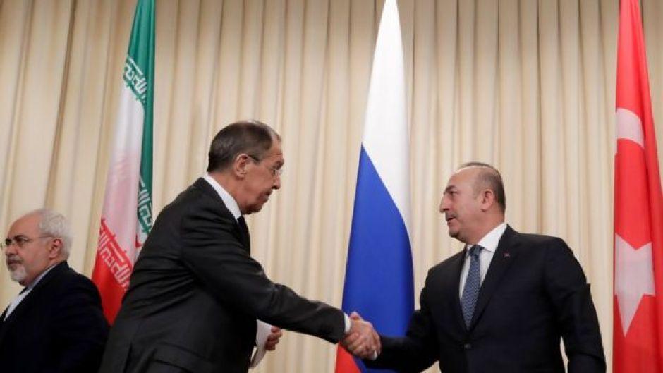 Los ministros de relaciones exteriores de Rusia, Turquía e Irán después de una reunión el 20 de diciembre de 2016