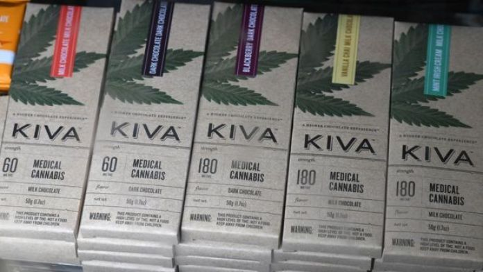 "Chocolate bars with cannabis called ""edibles"" are for sale at the Higher Path medical marijuana dispensary in the San Fernando Valley area of Los Angeles, California, 27 December 2017"