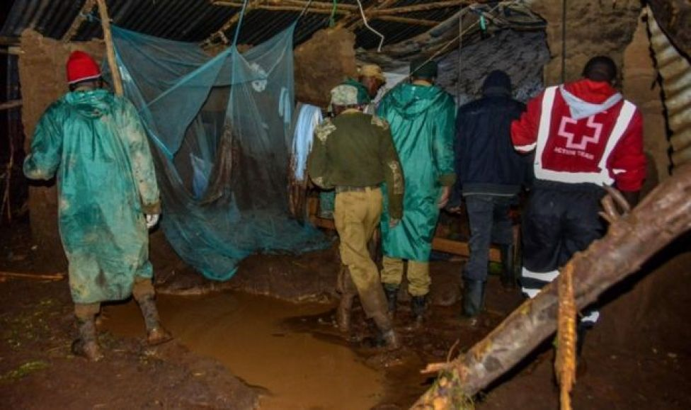 Volunteers search for survivors in a residential area affected by the damburst