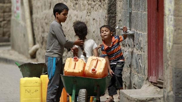 Yemeni children carry jerry cans to fill them with water amid an acute water shortage in Sanaa