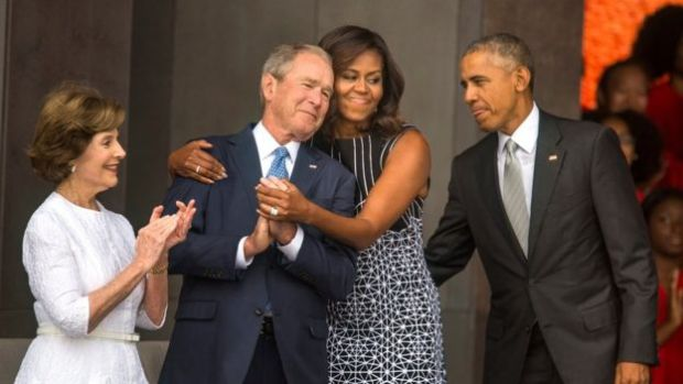 US First Lady Michelle Obama (C-R) hugs former President George W. Bush (C-L) while President Barack Obama (R) and former First Lady Laura Bush (L) look on at the opening of the Smithsonian's National Museum of African American History and Culture in Washington, DC, USA, 24 September 2016.