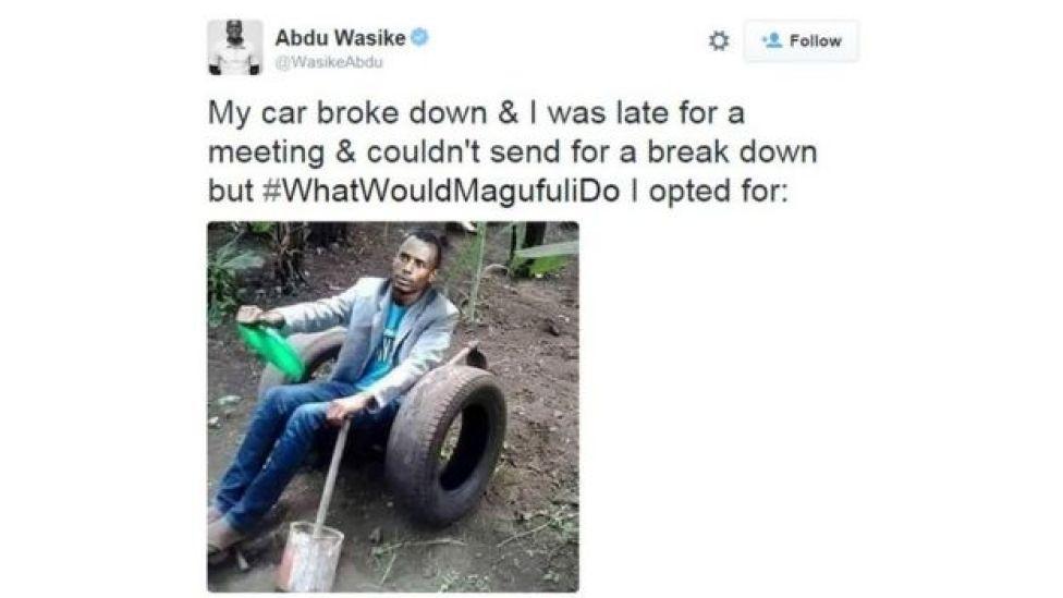 man sits in fake car