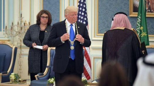 US President Donald Trump (C) receives the Order of Abdulaziz al-Saud medal from Saudi Arabia