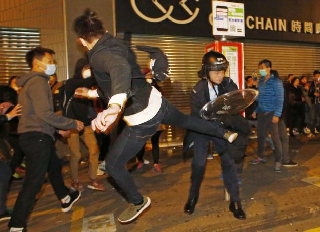A protester kicks a riot police in Mong Kok district of Hong Kong, Tuesday, 9 February 2016.