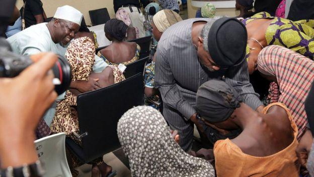 Nigeria's Vice President Yemi Osinbajo welcomes some of the freed Chibok schoolgirls in Abuja