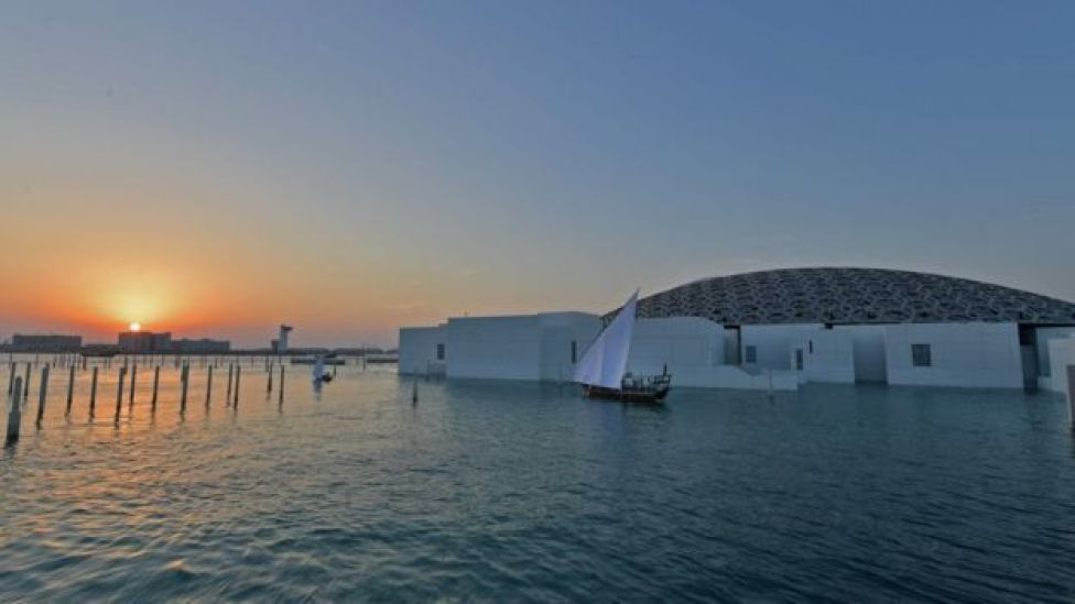 A general view shows part of the Louvre Abu Dhabi Museum designed by French architect Jean Nouvel on 8 November 2017 prior to the inauguration of the museum on Saadiyat island in the Emirati capital.