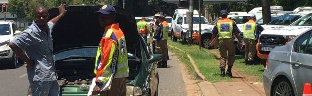 A road block operation in Rosebank, Johannesburg where a passenger's vehicle is being checked for road worthiness