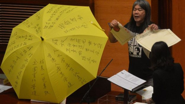 Leung Kwok-hung - known as 'Long Hair' - of the League of Social Democrats shouts slogans and rips up the '831 ruling' before taking the Legislative Council Oath at the first meeting of the Sixth Legislative Council (Legco) in Hong Kong on October 12, 2016