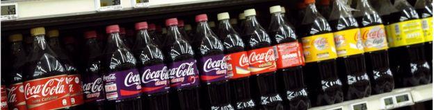 Bottles of Coca Cola on a supermarket shelf