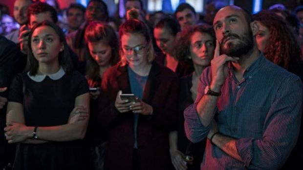 Macron supporters watch the debate in Paris on 3 May 2017