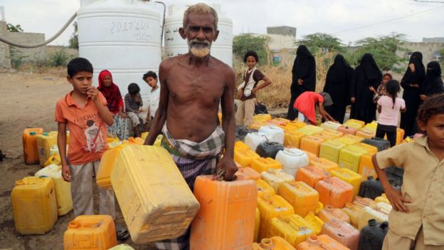 Yemenis collect water from a donated source amid continuing disruption of water supply in the impoverished coastal village on the outskirts of the Yemeni port city of Hodeidah, on February 20, 2017