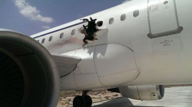 Daalo Airlines plane with n hole in its side