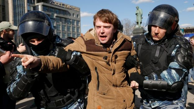 Police detain a protester in downtown Moscow