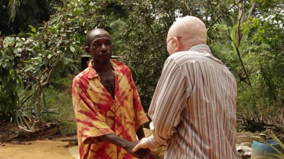 the witch doctor and Stephane shake hands