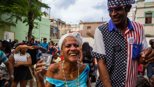Two Cubans smile widely as they take part in a weekly rumba dance gathering in Havana, Cuba, Saturday, March 19