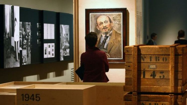 A visitor looks at a painting at the 'Looting and Restitution' ('Raub und Restitution') exhibition at the Jewish Museum on September 18, 2008 in Berlin, Germany. The exhibition detailed the looting of Jewish art collections and household objects by the Nazi regime before and during the Second World War. and the various institutions put in place to find and return the looted goods.