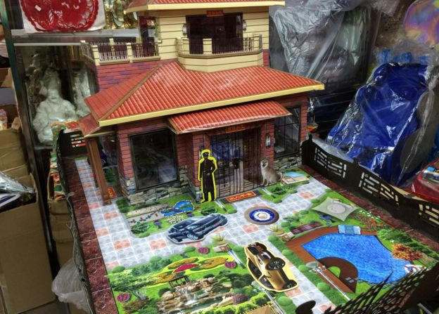 Villa with guard and maid made of paper