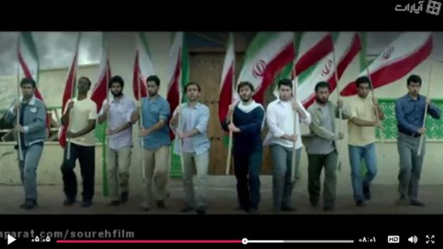 Iranian men line up with flags