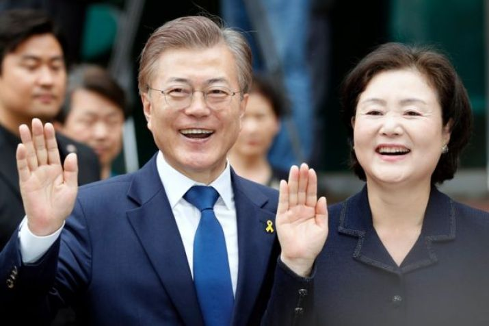 Moon Jae-in (L), presidential candidate of the Democratic Party of Korea (The Minjoo Party of Korea), and wife Kim Jeong-suk, pose for a photo after casting their ballots at a polling station in a junior high-school in Seoul, South Korea, 9 May 2017